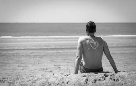 embracement: he is looking and relaxing at the seaside in retro old fashioned style Stock Photo