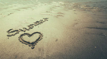 text handwritten on the beach during the holidays Stock Photo
