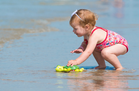 she is having fun with a turtle toy