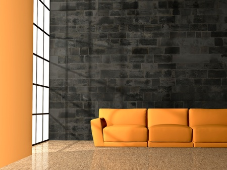 spacious: orange couch in front of a black rock wall, in a well lid room Stock Photo
