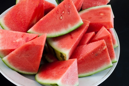 Pieces of watermelon served on a white plate Stock Photo