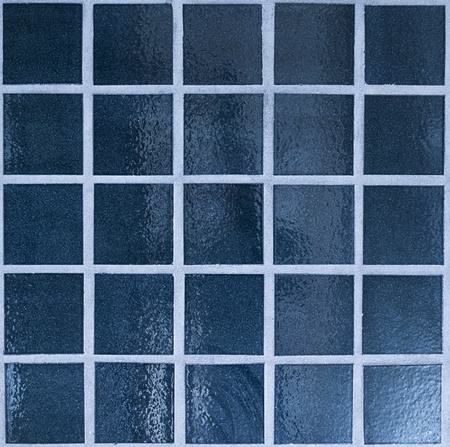 Close up of dark blue tiled wall photo