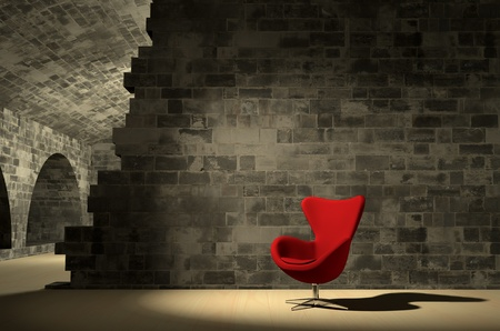 Red modern chair in ancient surroundings Stock Photo