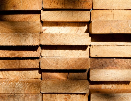 Close-up of stacked larch planks photo