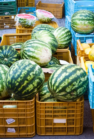 Watermelons in plastic boxes at a market stand in Mallorca Spain