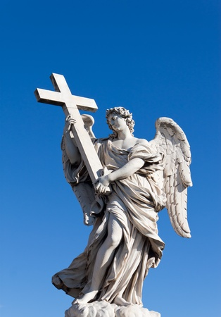 A statue of an angel with Cross