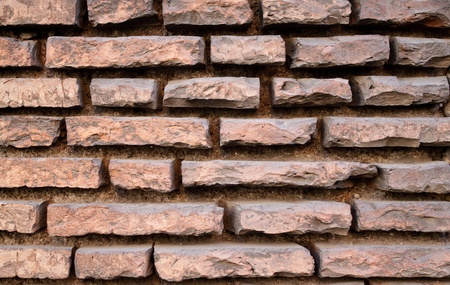 Old red brick wall with very recessed joints Stock Photo