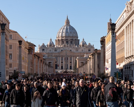 Crowd of people leaving St. Peters Cathedrals square on christmas day