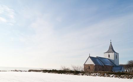 Smalle danish church in a winter landscape Stock Photo