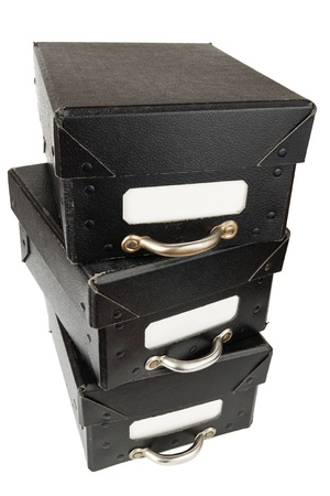 Three black archive boxes stacked on top of each other