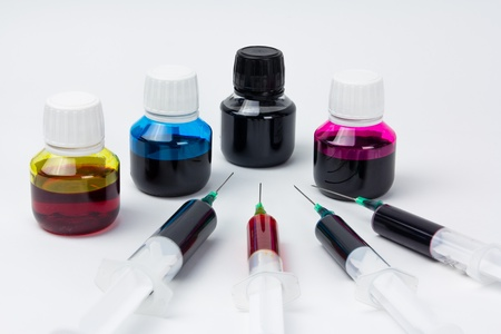 Inkjet refill tools and cmyk ink photo