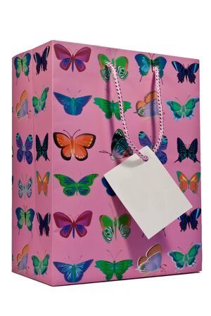 A pink giftbag with butterflies and an empty greeting card photo