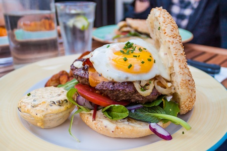 Beefburger with egg, on a plate