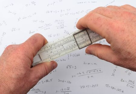 Two hands holding a slide rule or slipstick Stock Photo - 13518859