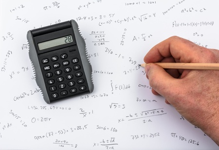 Person doing calculations on paper and calculator