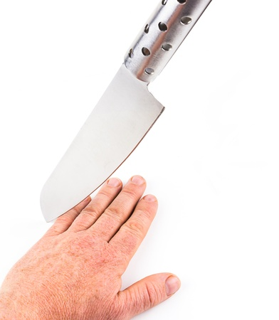metal knife threatening hand that is lying on a white surface Stock Photo - 14403607
