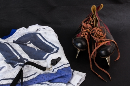 Pair of old hockey skates a whistle and a jersey Stock Photo