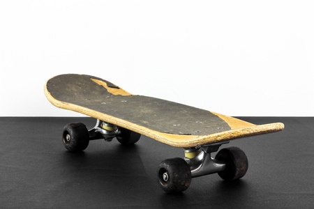 Old skateboard on black and white background Stock Photo