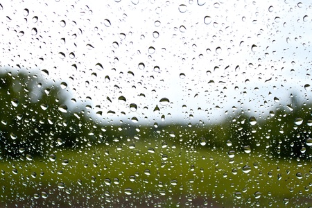 unclear: Droplets on a window facing a garden landscape Stock Photo