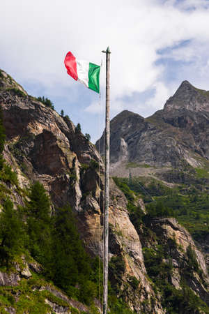 Italian flag on a grungy pole at the Toce waterfall Stock Photo