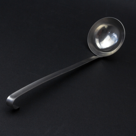 Ladle or soup scoop on a black background