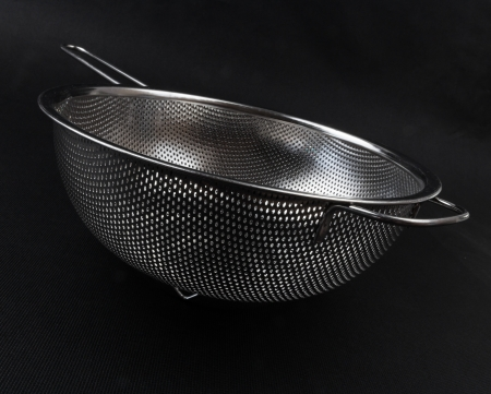 Stainless colander on black background Stock Photo - 15167971