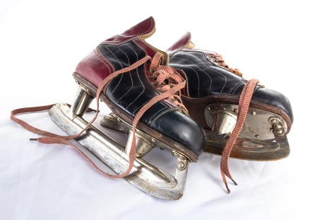 Two very old ice hockey skates on white background photo