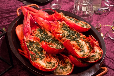 Dish with cooked and halfed lobsters Stock Photo