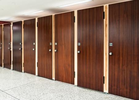 Eight rosewood doors at public restroom Stock Photo
