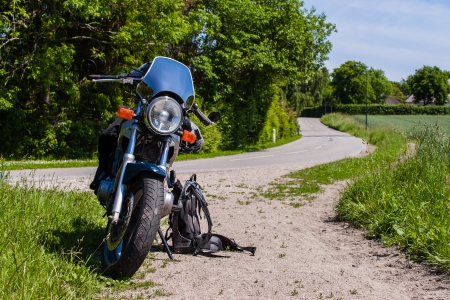 Motorcycle parked at a country road side photo