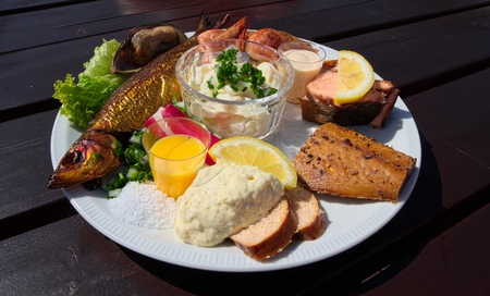 Traditional danish fish plate with different kind of smoked fish Stock Photo