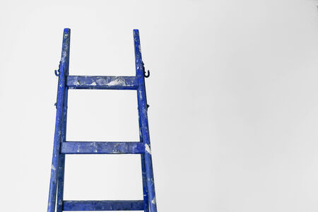 Frontview of the top of a wood ladder Stock Photo
