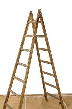 Wood ladder standing on a cardboard covered floor photo