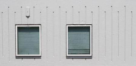 Two windows in a gray concrete facade photo