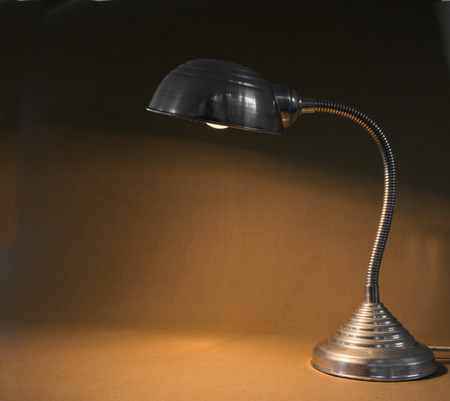 Sideview of a small office metal lamp