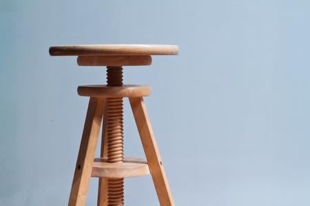 Three legged stool with adjustable seat photo