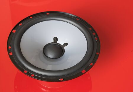 Speaker bass componenet on red background Stock Photo