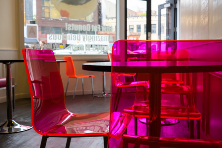 pink transparent acrylic chairs in a cafe