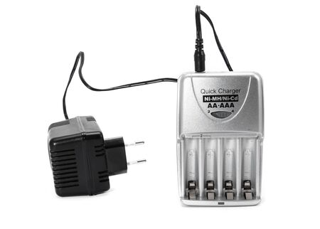 Battery charger standing on white background Stock Photo
