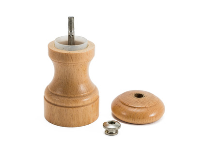 small wooden pepper grinder in three pieces Stock Photo