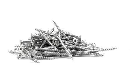 woodscrew: Wood torx screws lying in a pile on a white surface