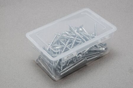 Top view of a closed plastic box filled with torx screws Stock Photo
