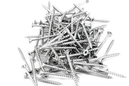 woodscrew: Bunch of wood srews lying on white surface