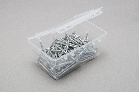 woodscrew: Open screw box standing o na gray surface
