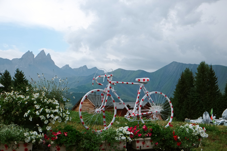 eye catcher: a polka dot painted racing bike put up in the french alps, as an eye catcher for the tour de france