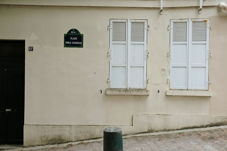 plaster of paris: Parisien town house facade with closed shutters made of wood