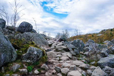 rockslide: rough stone paved pathway up a mountain side in norway