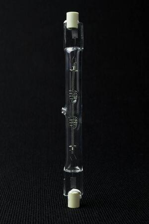 socle: Linear halogen tube on black background