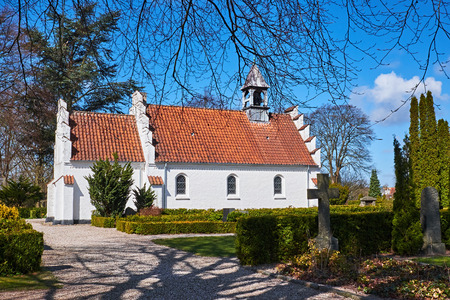 red clay: Classic white danish brick chapel with red clay layered roof tiles and a small bell tower