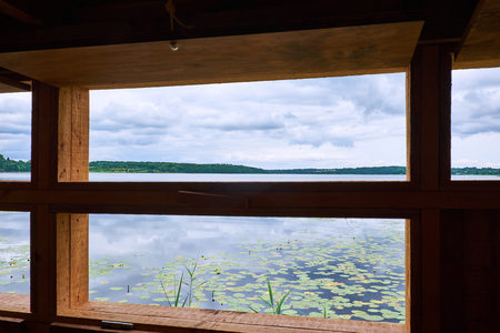 Looking out over lake Sjaelsoe, in Denmark, from within a birdwatch shed